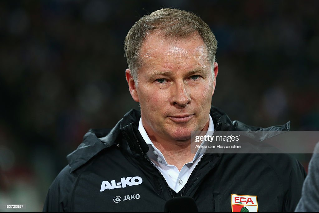 Stefan Reuter sporting director of Augsburg looks on prior to the Bundesliga match between FC Augsburg and Bayer Leverkusen at SGL Arena on March 26...