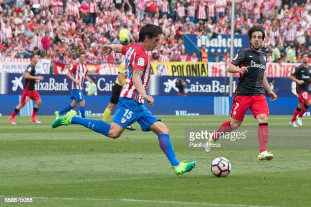 Stefan Savic clear the ball over the pressure of Beñat Etxebarria during the football match between Atletico de Madrid and Athletic de Bilbao...