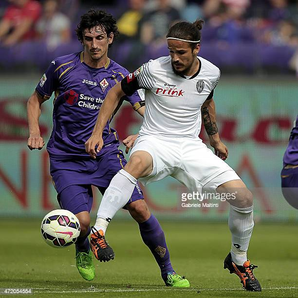 Stefan Savic of ACF Fiorentina battles for the ball with Alejandro Rodriguez of AC Cesena during the Serie A match between ACF Fiorentina and AC...