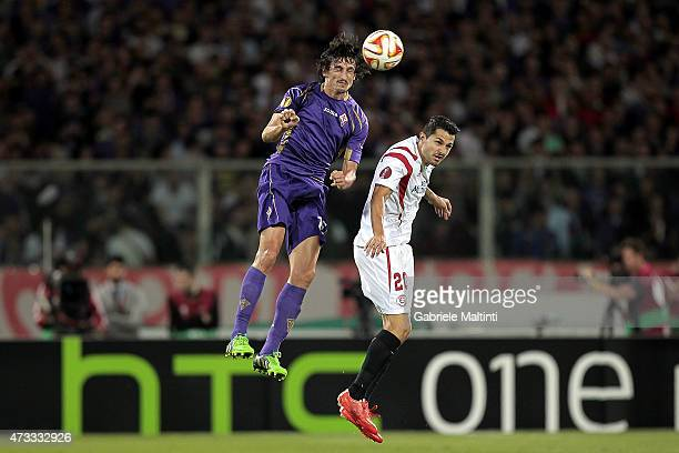 Stefan Savic of ACF Fiorentina battles for the ball with Vitolo of FC Sevilla during the UEFA Europa League Semi Final match between ACF Fiorentina...