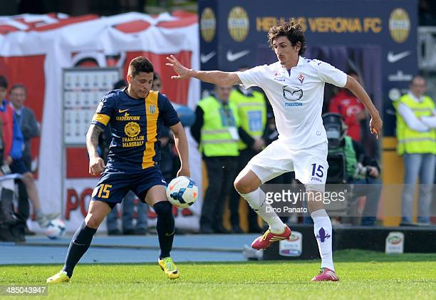 Stefan Savic of ACF Fiorentina competes with Iturbe Juam Manuel Arevalos of Hellas Veona during the Serie A match between Hellas Verona FC and ACF...