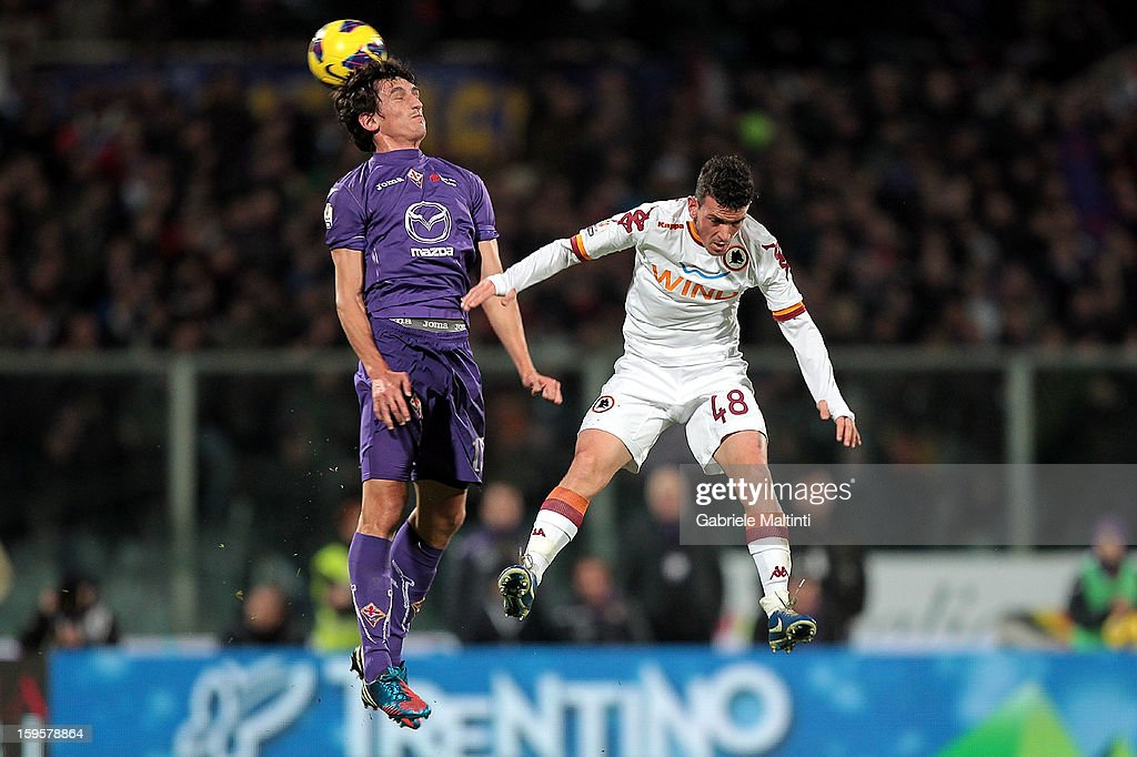 <a gi-track='captionPersonalityLinkClicked' href=/galleries/search?phrase=Stefan+Savic&family=editorial&specificpeople=6135329 ng-click='$event.stopPropagation()'>Stefan Savic</a> of ACF Fiorentina fights for the ball with Alessandro Florernzi of AS Roma during the TIM cup match between ACF Fiorentina and AS Roma at Artemio Franchi on January 16, 2013 in Florence, Italy.
