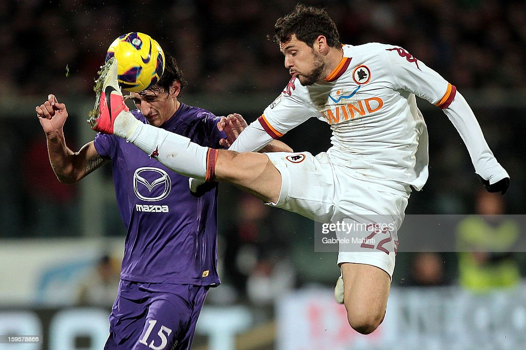 Stefan Savic of ACF Fiorentina fights for the ball with Mattia Destro of AS Roma during the TIM cup match between ACF Fiorentina and AS Roma at Artemio Franchi on January 16, 2013 in Florence, Italy.