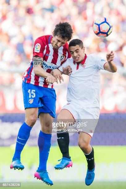 Stefan Savic of Atletico de Madrid battles for the ball with Wissam Ben Yedder of Sevilla FC during their La Liga match between Atletico de Madrid...