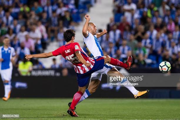 Stefan Savic of Atletico de Madrid fights for the ball with Nourredine Amrabat of CD Leganes during the La Liga 201718 match between CD Leganes and...