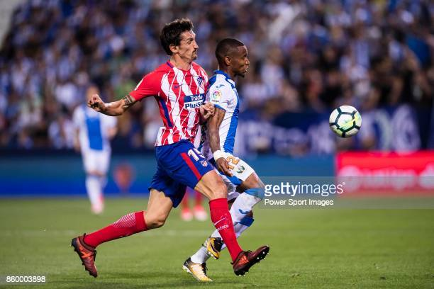 Stefan Savic of Atletico de Madrid fights for the ball with Claudio Beauvue of CD Leganes during the La Liga 201718 match between CD Leganes and...