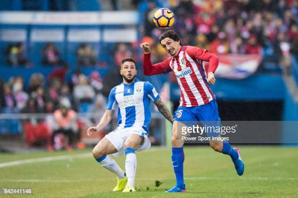 Stefan Savic of Atletico de Madrid fights for the ball with Pablo Insua of Deportivo Leganes during their La Liga match between Atletico de Madrid...