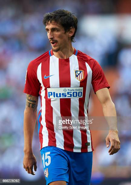 Stefan Savic of Atletico de Madrid looks on during the La Liga match between Real Madrid CF and Atletico de Madrid at Estadio Santiago Bernabeu on...