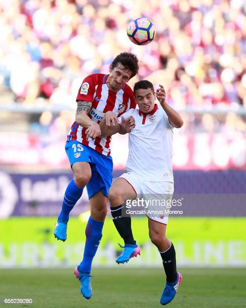 Stefan Savic of Atletico de Madrid wins the header before Wissam Ben Yedder during the La Liga match between Club Atletico de Madrid and Sevilla FC...