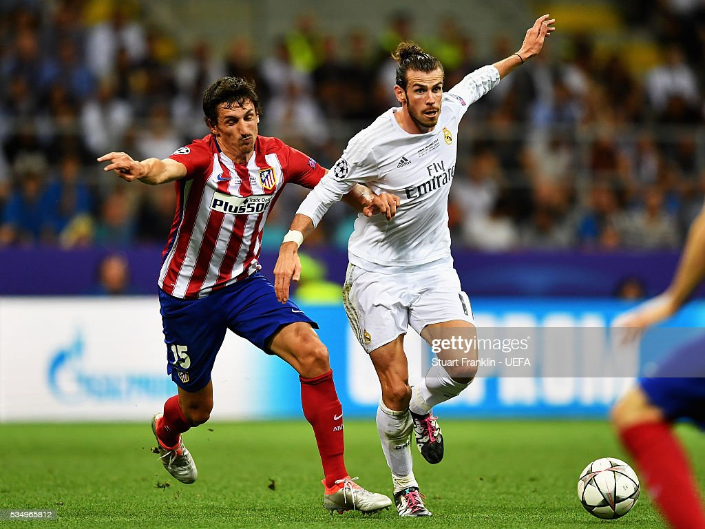 <a gi-track='captionPersonalityLinkClicked' href=/galleries/search?phrase=Stefan+Savic&family=editorial&specificpeople=6135329 ng-click='$event.stopPropagation()'>Stefan Savic</a> of Atletico Madrid tackles <a gi-track='captionPersonalityLinkClicked' href=/galleries/search?phrase=Gareth+Bale&family=editorial&specificpeople=609290 ng-click='$event.stopPropagation()'>Gareth Bale</a> of Real Madrid during the UEFA Champions League Final between Real Madrid and Club Atletico de Madrid at Stadio Giuseppe Meazza on May 28, 2016 in Milan, Italy..