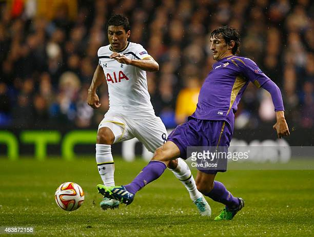Stefan Savic of Fiorentina clears the ball from Paulinho of Spurs during the UEFA Europa League Round of 32 first leg match between Tottenham Hotspur...