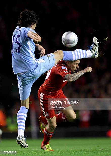 Stefan Savic of Manchester City competes with Craig Bellamy of Liverpool during the Carling Cup Semi Final Second Leg match between Liverpool and...