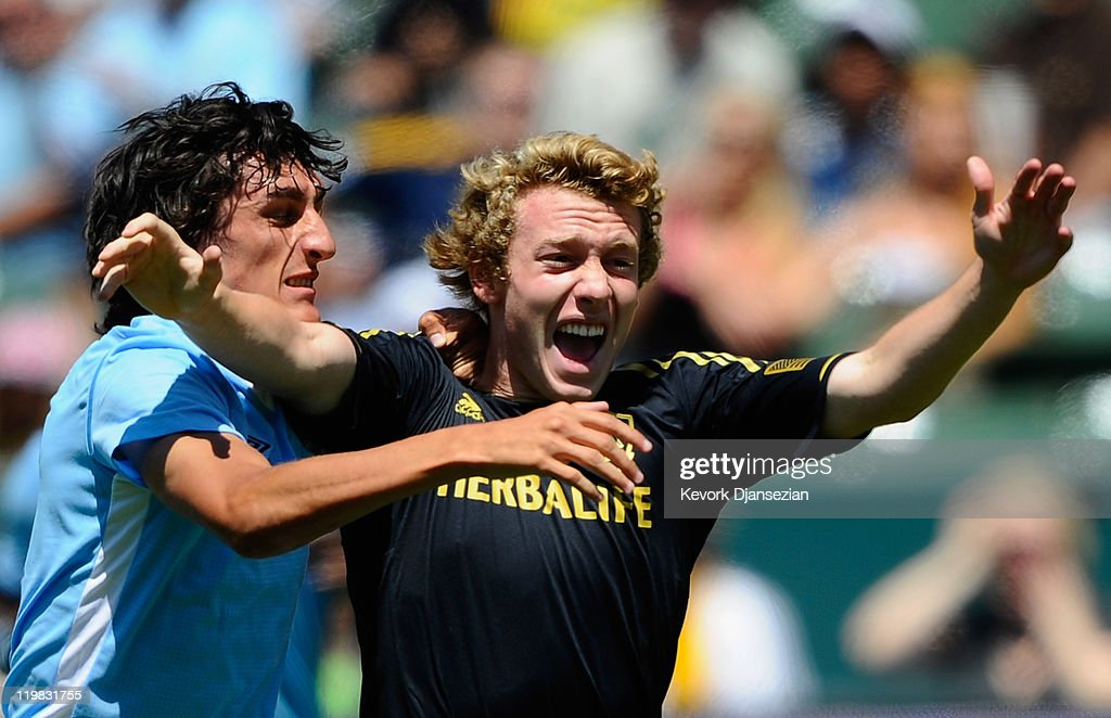 Stefan Savic #15 of Manchester City tackles Jack McBean #32 of Los Angeles Galaxy during the Herbalife World Football Challenge 2011 at the Home Depot Center on July 24, 2011 in Carson, California.