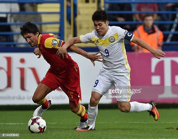 Stefan Savic of Montenegro and Bauyrzhan Islamkhan of Kazakhstan in action during the FIFA 2018 World Cup Qualifier between Montenegro and Kazakhstan...