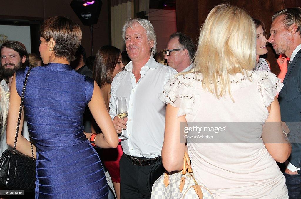 Stefan Schaffelhuber and company attend the Eclat Dore summer party at Hotel Vier Jahreszeiten Kempinski on July 23, 2014 in Munich, Germany.