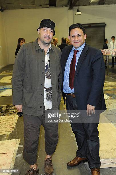 Stefan Simchowicz and Cesar Garcia at the Oscar Murillo Distribution Center VIP Opening Reception at The Mistake Room on January 17 2014 in Los...