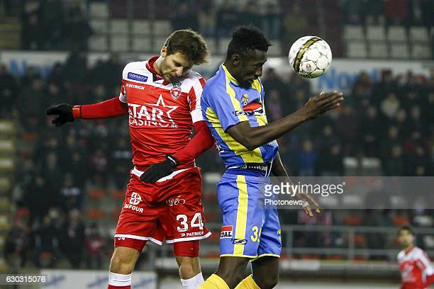Stefan Simic defender of Royal Excel Mouscron in an airduel with Silvere Ganvoula forward of KVC Westerlo during the Jupiler Pro League match between...