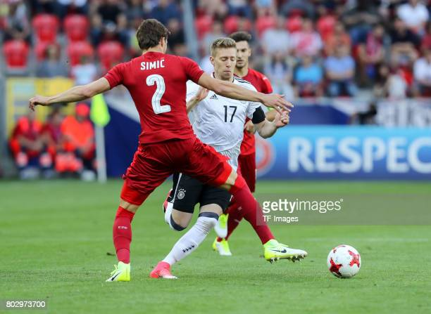 Stefan Simic of Czech Republic and Mitchell Weiser of Germany battle for the ball during the UEFA European Under21 Championship Group C match between...