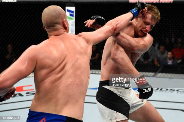 Stefan Struve of The Netherlands punches Alexander Volkov of Russia in their heavyweight bout during the UFC Fight Night event at the Rotterdam Ahoy...