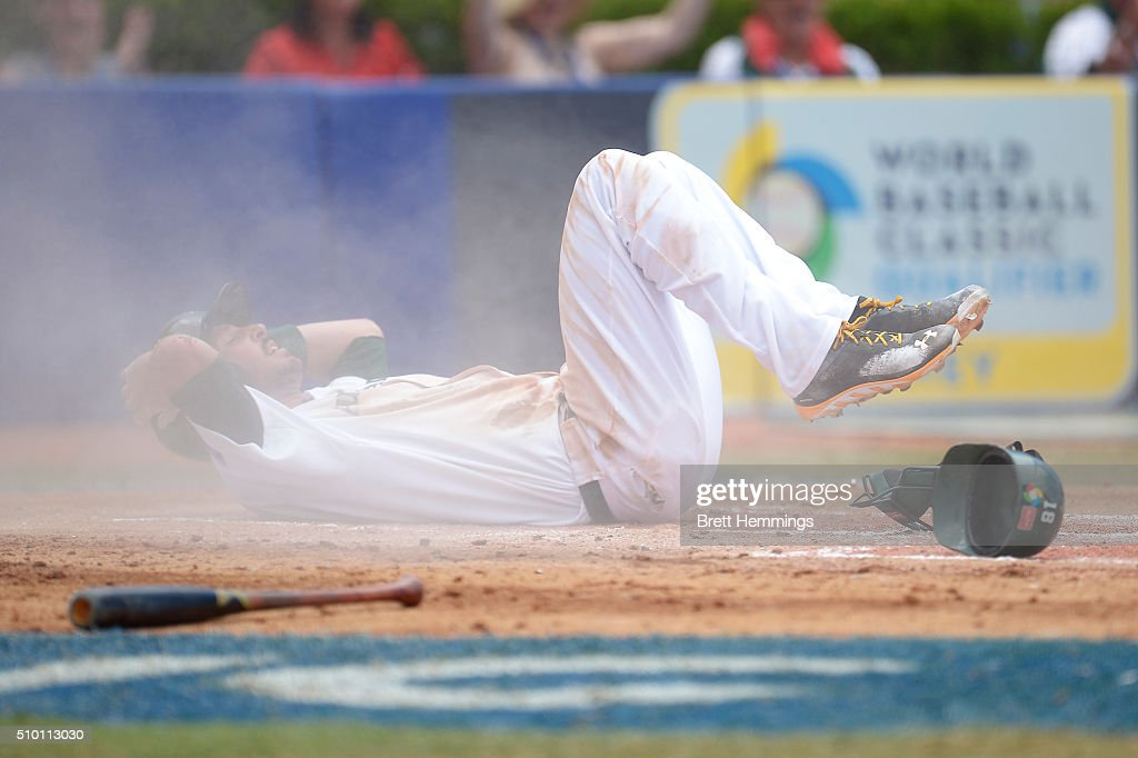Stefan Welch of Australia is run out after sliding into home base during the World baseball Classic Final match between Australia and South Africa at Blacktown International Sportspark on February 14, 2016 in Sydney, Australia.