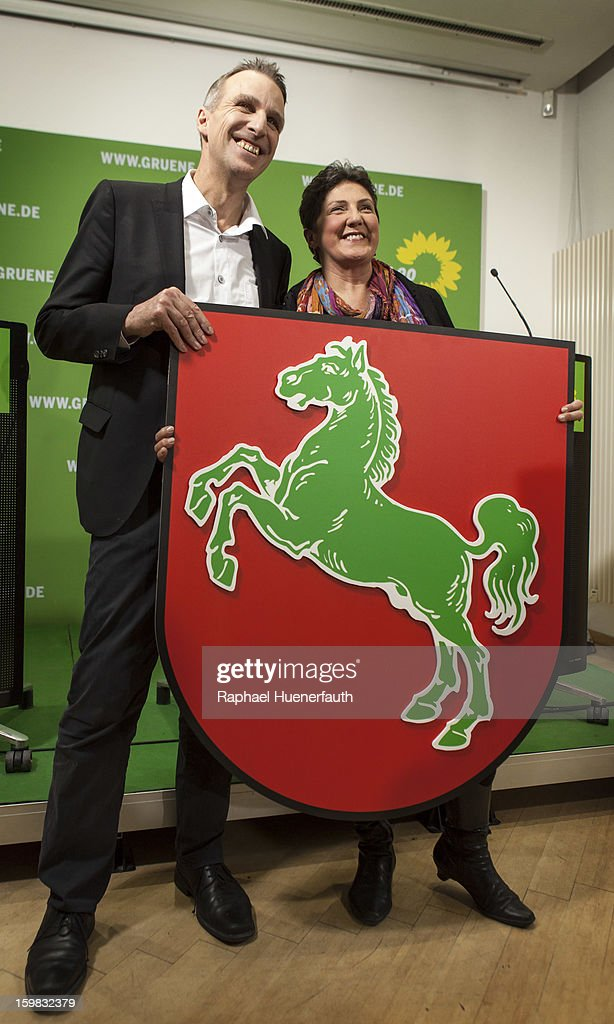 Stefan Wenzel, candidate in Lower Saxony for the German Greens and Anja Piel, member of the Greens in Lower Saxony, show their emblem of Lower Saxony with the green horse at a press conference, the day after the German Social Democrats (SPD) and German Greens party emerged with a hairline victory in Lower Saxony on January 21, 2013 in Berlin, Germany. The result of the German Greens is the best result they have had to date and Germany will face their national elections later this year.