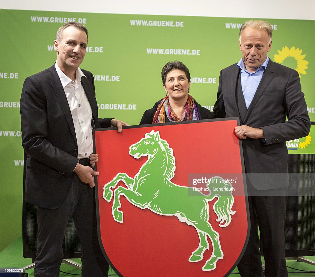 Stefan Wenzel, candidate in Lower Saxony for the German Greens, Anja Piel, member of the Greens in Lower Saxony and <a gi-track='captionPersonalityLinkClicked' href=/galleries/search?phrase=Juergen+Trittin&family=editorial&specificpeople=571129 ng-click='$event.stopPropagation()'>Juergen Trittin</a>, leader Greens party's parliamentary group, show their emblem of Lower Saxony with the green horse at a press conference, the day after the German Social Democrats (SPD) and German Greens party emerged with a hairline victory in Lower Saxony on January 21, 2013 in Berlin, Germany. The result of the German Greens is the best result they have had to date and Germany will face their national elections later this year.