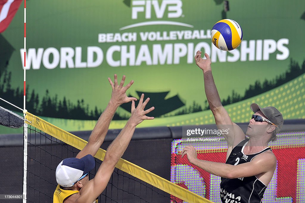 Stefan Windscheif (R) from Germany attacks during the match between Latvia and from Germany during Day 5 of the FIVB World Championships on July 5, 2013 in Stare Jablonki, Poland.