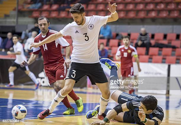 Stefan Winkel of Germany challenges Ernest Akopov of Armenia during the UEFA Futsal European Championship Qualifying match between Armenia and...