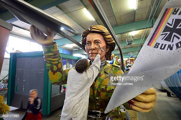 Stefan Wolleck works at the Carnival parade float satirizing the German minister of defence Ursula von der Leyen themed 'Ready for TakeOff' on...