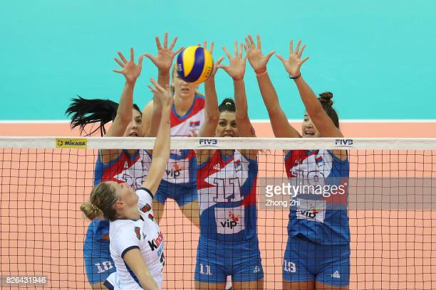 Stefana Veljkovic #18 Tijana Boskovic and Bojana Milenkovic of Serbia in action against Sara Loda of Italy during the match between Serbia and Italy...