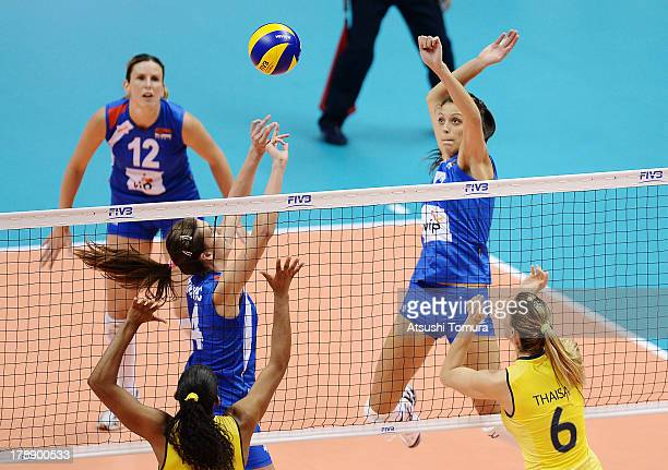 Stefana Veljkovic of Serbia spikes the ball during day four of the FIVB World Grand Prix Sapporo 2013 match between Brazil and Serbia at Hokkaido...