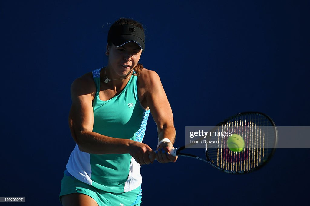 Stefani Stojic of Australia plays a backhand in her first round match against Shilin Xu of China during the 2013 Australian Open Junior Championships at Melbourne Park on January 19, 2013 in Melbourne, Australia.