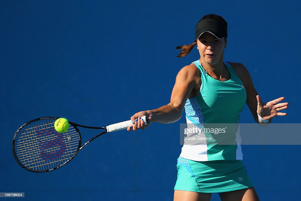 Stefani Stojic of Australia plays a forehand in her first round match against Shilin Xu of China during the 2013 Australian Open Junior Championships at Melbourne Park on January 19, 2013 in Melbourne, Australia.