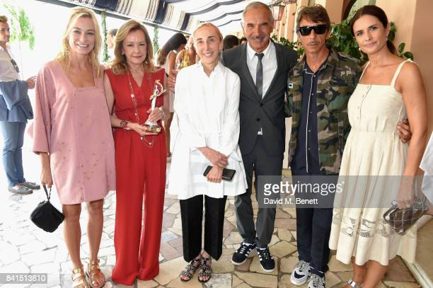 Stefania Rocca Felice Caroline Scheufele Carla Sozzani Carlo Capasa Pierpaolo Piccioli and Livia Firth attend an intimate lunch hosted by Livia Firth...