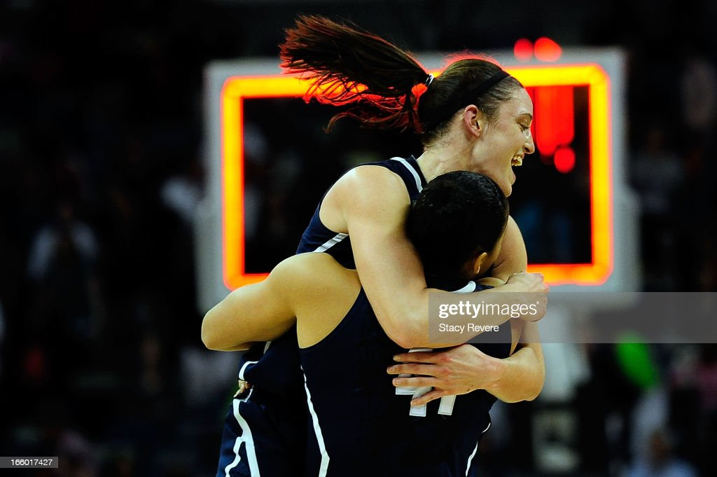 Stefanie Dolson #31 and Kiah Stokes #41 of the Connecticut Huskies celebrate victory over the Notre Dame Fighting Irish in the National Semifinal game of the 2013 NCAA Division I Women's Basketball Championship at the New Orleans Arena on April 7, 2013 in New Orleans, Louisiana. Connecticut won the game 83-65.