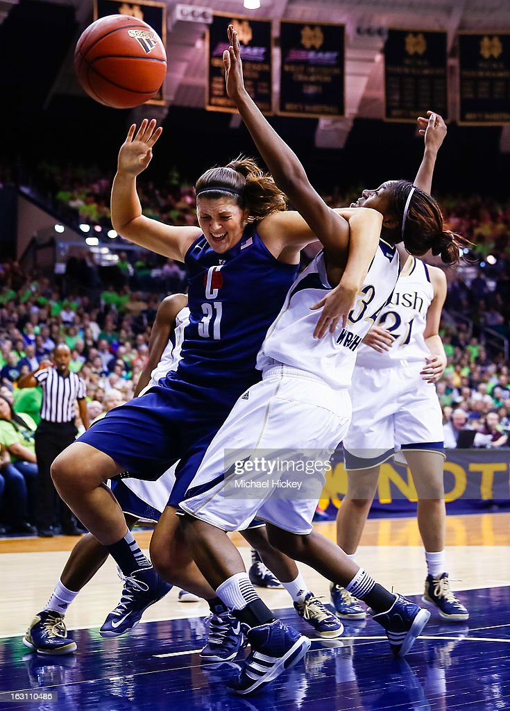 Stefanie Dolson #31 of the Connecticut Huskies and Markisha Wright #34 of the Notre Dame Fighting Irish battle for the ball at Purcel Pavilion on March 4, 2013 in South Bend, Indiana. Notre Dame defeated Connecticut 96-87 in triple overtime to win the Big East regular season title.