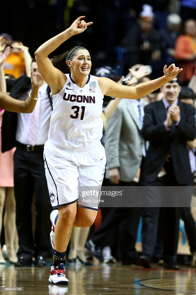 Stefanie Dolson #31 of the Connecticut Huskies celebrates after defeating the Notre Dame Fighting Irish 79 to 58 in the NCAA Women's Final Four Championship at Bridgestone Arena on April 8, 2014 in Nashville, Tennessee.