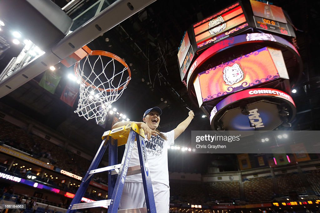 Stefanie Dolson #31 of the Connecticut Huskies cuts down the net after defeating the Louisville Cardinals during the 2013 NCAA Women's Final Four Championship at New Orleans Arena on April 9, 2013 in New Orleans, Louisiana.