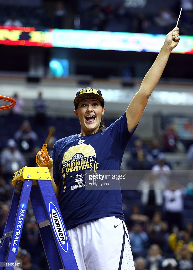 Stefanie Dolson #31 of the Connecticut Huskies cuts down the net after defeating the Notre Dame Fighting Irish 79 to 58 in the NCAA Women's Final Four Championship at Bridgestone Arena on April 8, 2014 in Nashville, Tennessee.