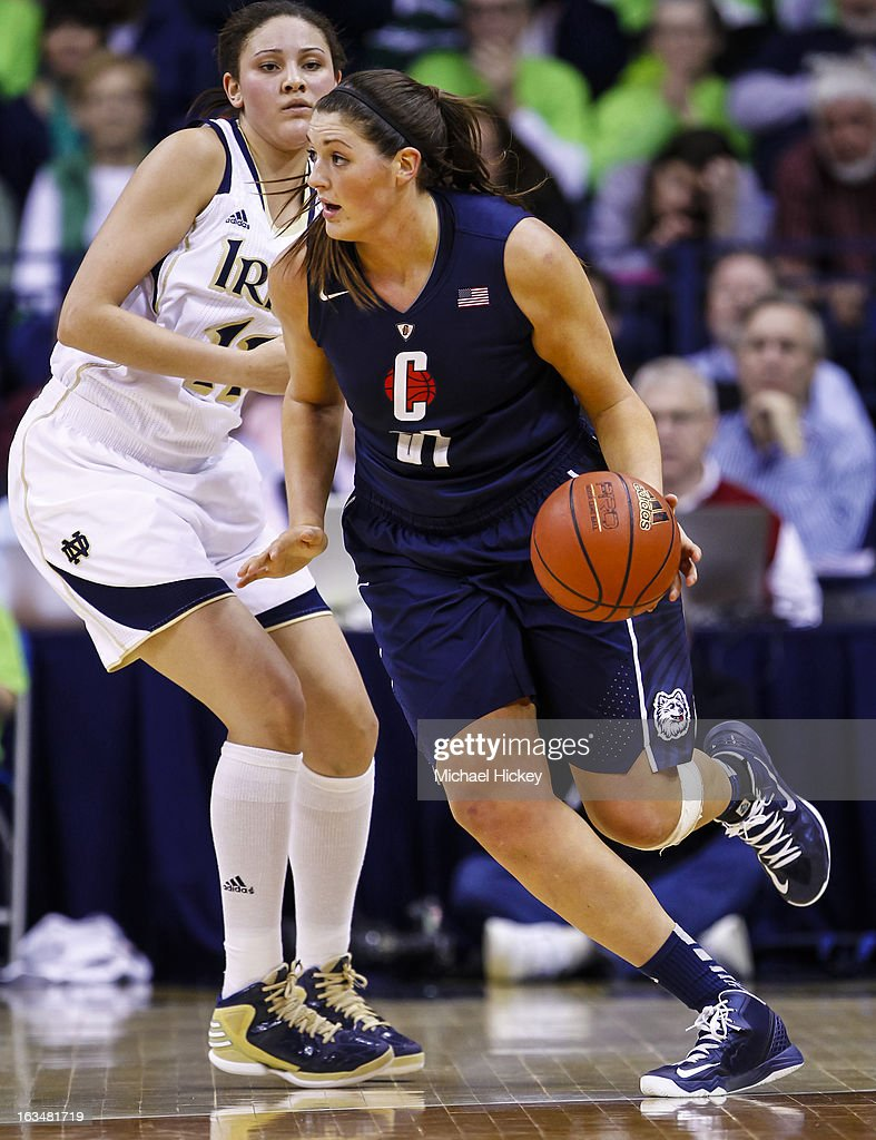 Stefanie Dolson #31 of the Connecticut Huskies dribbles the ball around Natalie Achonwa #11 of the Notre Dame Fighting Irish at Purcel Pavilion on March 4, 2013 in South Bend, Indiana. Notre Dame defeated Connecticut 96-87 in triple overtime to win the Big East regular season title.