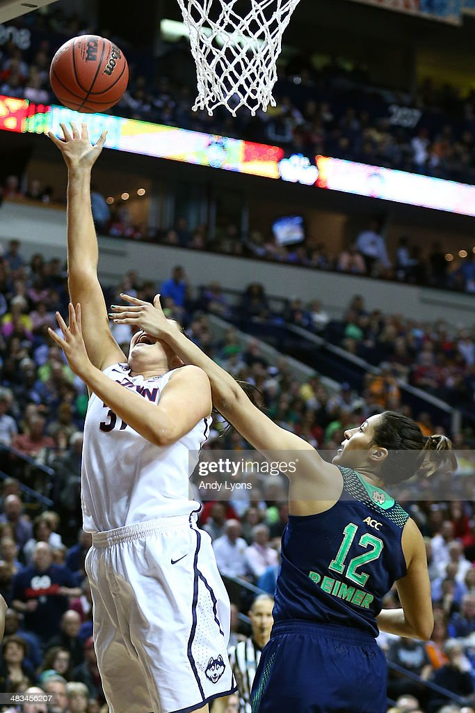 Stefanie Dolson #31 of the Connecticut Huskies gets fouled by Taya Reimer #12 of the Notre Dame Fighting Irish in the second half during the NCAA Women's Final Four Championship at Bridgestone Arena on April 8, 2014 in Nashville, Tennessee.