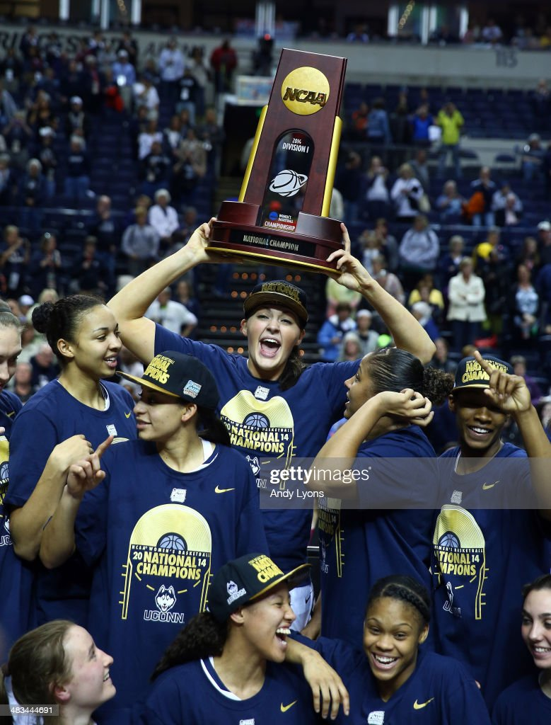 Stefanie Dolson of the Connecticut Huskies hoist the trophy after defeating the Notre Dame Fighting Irish 79 to 58 in the NCAA Women's Final Four...