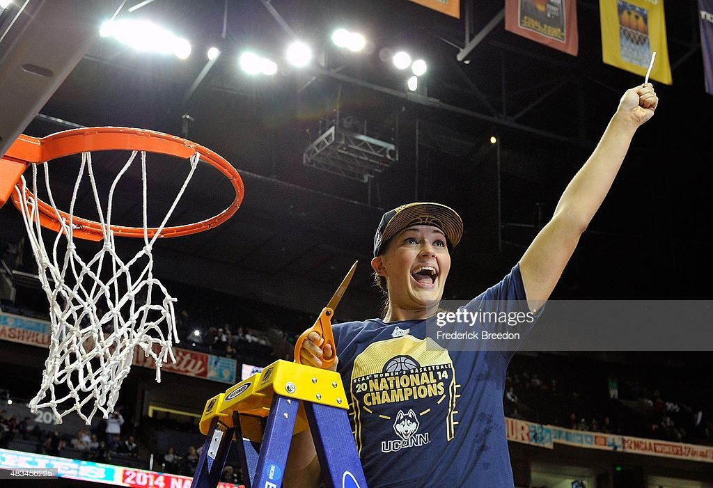 Stefanie Dolson #31 of the Connecticut Huskies holds up a piece of the net after a 79-58 victory over the Notre Dame Fighting Irish in the NCAA Women's Basketball Tournament Championship game at Bridgestone Arena on April 8, 2014 in Nashville, Tennessee.