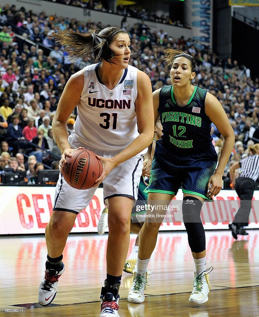 Stefanie Dolson #31 of the Connecticut Huskies plays against Taya Reimer #12 of the Notre Dame Fighting Irish during the NCAA Women's Basketball Tournament Championship game at Bridgestone Arena on April 8, 2014 in Nashville, Tennessee.