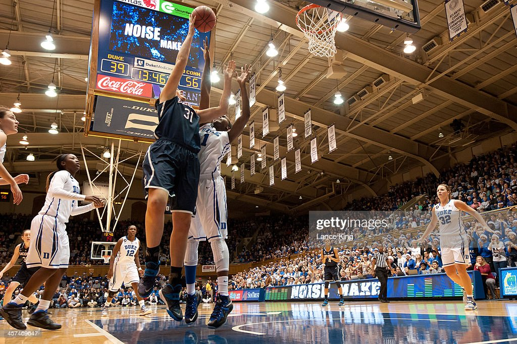 Stefanie Dolson #31 of the Connecticut Huskies puts up a shot against Elizabeth Williams #1 of the Duke Blue Devils at Cameron Indoor Stadium on December 17, 2013 in Durham, North Carolina. Connecticut defeated Duke 83-61.