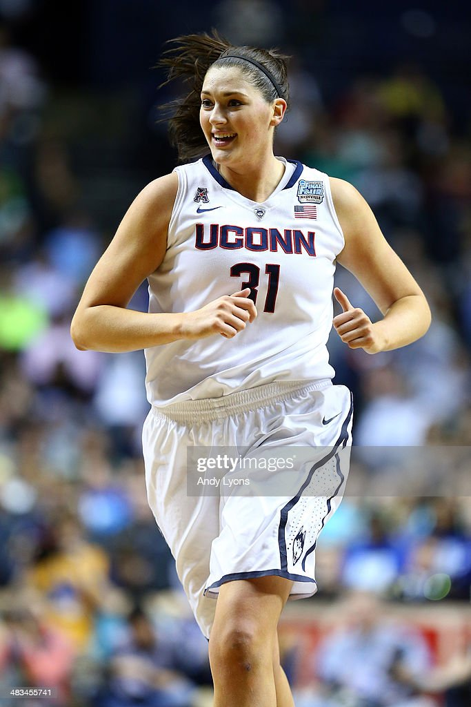 Stefanie Dolson #31 of the Connecticut Huskies reacts after a point against the Notre Dame Fighting Irish during the NCAA Women's Final Four Championship at Bridgestone Arena on April 8, 2014 in Nashville, Tennessee.