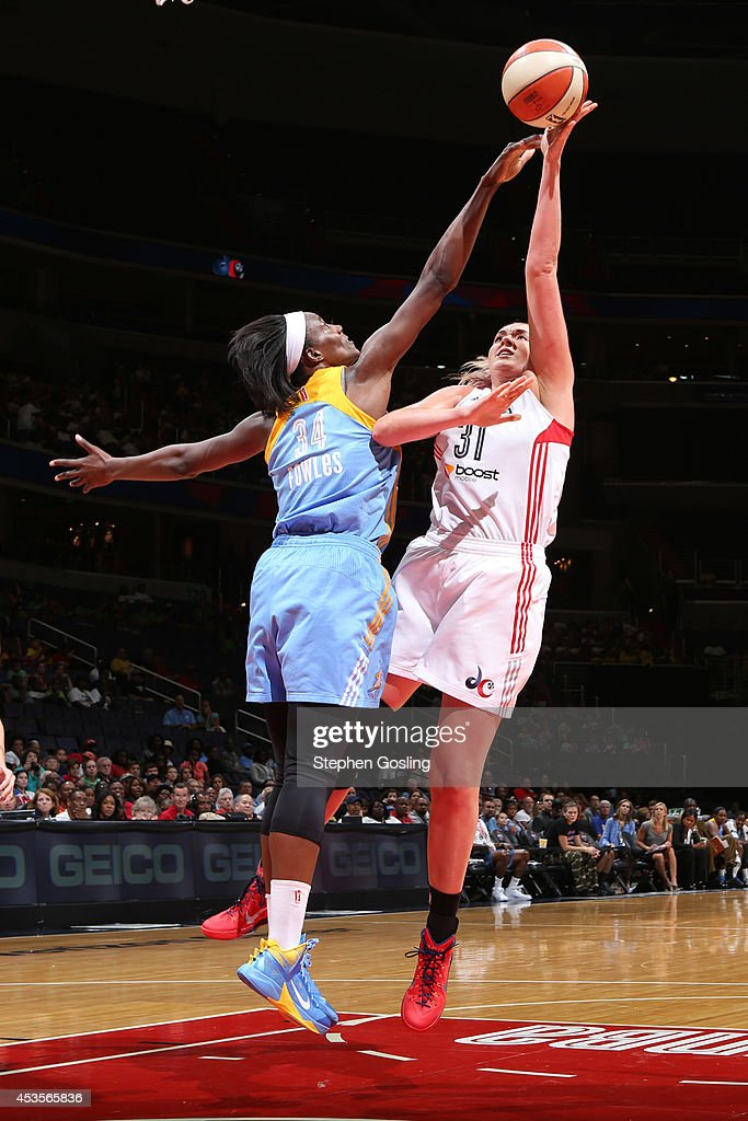 Stefanie Dolson #31 of the Washington Mystics shoots against Sylvia Fowles #34 of the Chicago Sky at the Verizon Center on August 13, 2014 in Washington, DC.