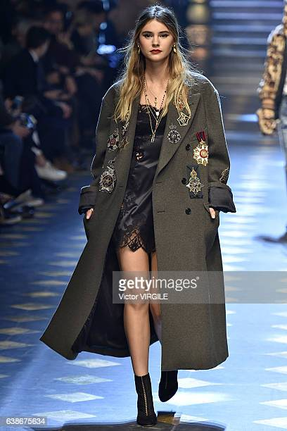 Stefanie Giesinger walks the runway at the Dolce Gabbana show during Milan Men's Fashion Week Fall/Winter 2017/18 on January 14 2017 in Milan Italy