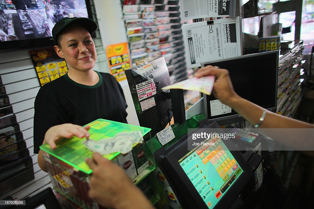 Stefanie Graef buys Powerball tickets at Circle News Stand on November 27, 2012 in Hollywood, Florida. The jackpot for Wednesday's Powerball drawing is currently at $500 million which is the richest Powerball pot ever. It is likely to rise even more as people continue to buy.