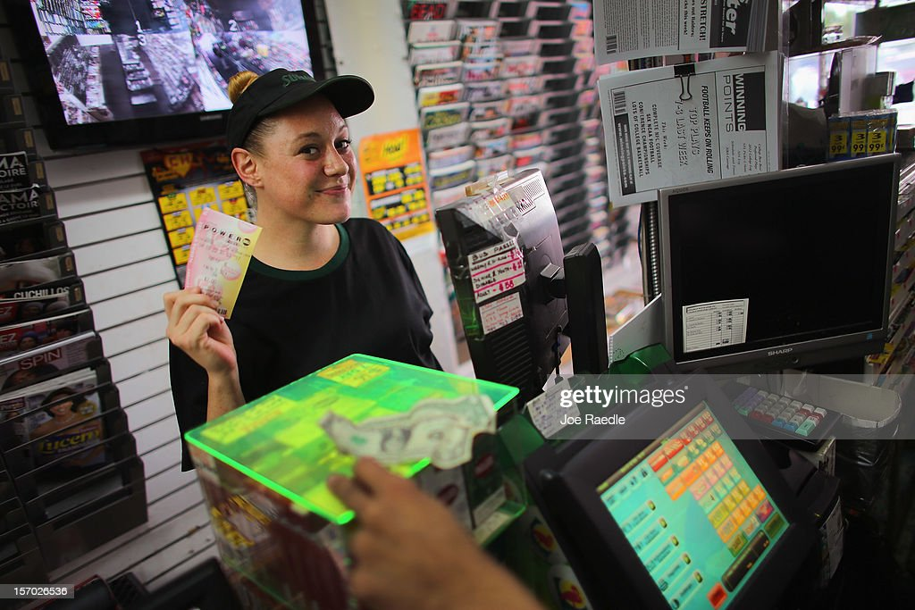 Stefanie Graef holds what she hopes is the winning Powerball ticket she just bought at Circle News Stand on November 27, 2012 in Hollywood, Florida. The jackpot for Wednesday's Powerball drawing is currently at $500 million which is the richest Powerball pot ever. It is likely to rise even more as people continue to buy.